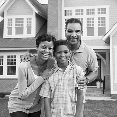 a family standing in front of a home